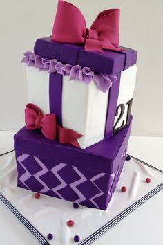 Gift Box Cake - This cake was created for a 21st birthday celebration. I used a few useful tutorials to create the bows, one was by Lesley at the Royal Bakery and the bow on top was created using Torta- Couture Cakes tutorial.