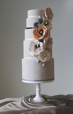 Tall wedding cake with intricate sugar flowers | Charm City Cakes West