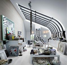 studio loft in stockholm. i'm loving this (click to see more) as much as frank lloyd wright's falling water. i want.