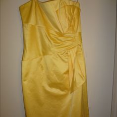 BCBG Paris strapless, yellow, cocktail dress Gorgeous yellow cocktail dress. Only worn once. Strapless with vertical modern bow detail in front. Hits above the knee. BCBG Dresses Midi