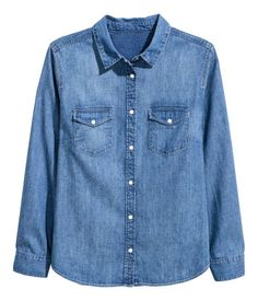 Denim blue. Shirt in soft, washed denim. Snap fasteners at front, chest pockets with flap and snap fastener, and rounded hem.