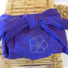 Traditional wrapping of gifts in Japan often was done without cutting the wrapping material.  By cleverly folding paper or cloth, you can reuse and recycle to create beautiful gifts and presents.