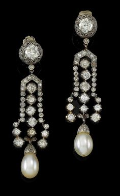 A pair of diamond and cultured pearl pendant ear screws. Platinum c. 900, old-cut octagonal diamonds and rhombs total weight c. 3 ct, cultured pearl tears, workmanship first third of the 20th century, 14.7 g, with case