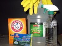 Kill and remove mildew with vinegar let sit 2-3 hours and wash/scrub away stains with hot water, baking soda and a disposable scrub brush!! No bleach or harsh chemicals.