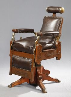 Carved Oak Barber Chair, 19th c with four cabriole legs with brass paw feet