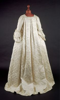 White silk satin open robe dress with sack-back and with matching petticoat and stomacher, ornamented with wadded and corded quilting and lined with white silk. 1751-1755