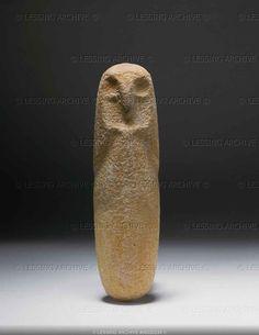 Stele, owl,light limestone. From Algeria.