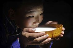 Nomads of Mongolia: An insight into their tribes, traditions and culture - January 27, 2018. A girl drinks fermented mare's milk (airag) in a dimly lit ger.