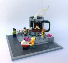 Cup o' Java by Miro Dudas.  Excellent MOC.  I love the cup shaped kiosk, especially the steam - genius! Also love the ground.  The 2-levels is great and the cobblestoned area is beautiful. LOVE THIS!