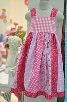 children at play dress... I like the idea of using a jelly roll to create the bottom of a dress or to sew up a skirt.