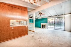 Eichler-esque paneling shows up on one or two walls in many of these original homes.