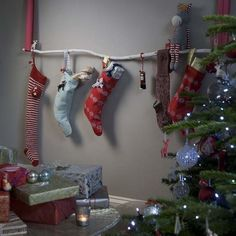 Hang stockings without a fireplace  No fireplace? No problem. Simply use two firmly attached lengths of ribbon to hang a slender, white-painted branch against a wall, and it's all set for your Christmas stockings. The eternally stylish Mr Claus will be very impressed with this modern decorating solution.