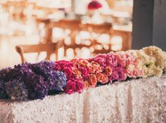 Ombre Table Runner | 20 Unexpected Wedding Flower Ideas | https://www.theknot.com/content/unique-wedding-flower-ideas