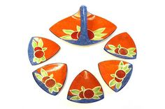 Clarice Cliff, an Orange Nuage sweetmeat set, triangular form, including basket and five plates