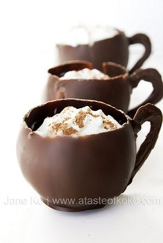 """DIY chocolate cups: Unless you want a melty mess, you can't sip hot cocoa out of these cups. But you can still serve """"hot chocolate"""" by adding cayenne pepper to chilled mousse. This is such a fun project because the little mugs are made with balloons!"""