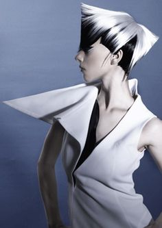 minimalist vest featuring an oversized asymmetrical collar - avant garde hairstyle - source not provided - pinned by RokStarroad.com