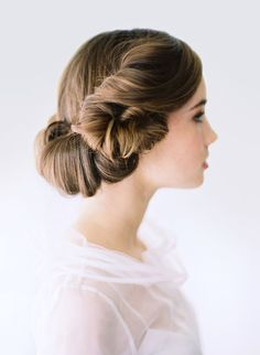 Lovely, full wrap-around rolled-in up-do. Fancy, delicate, yet still makes a low-key statement