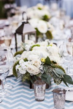 Pretty White Flower Mix for Centerpieces - Chevron Table Runners - See more on #smp here: http://www.StyleMePretty.com/midwest-weddings/2014/04/11/romantic-wine-country-wedding/ Vrai Photography - vraiphoto.com