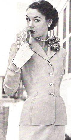 Handmacher 1952. Four button jacket with  elegant curved topstitching.