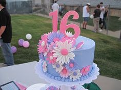 This cake was for a Sweet 16 birthday. The cupcakes are chocolate and strawberry cake, and the top tier is white cake. 12th Birthday Cake, Sweet 16 Birthday Cake, Adult Birthday Cakes, Birthday Fun, Birthday Ideas, Sweet 16 Cupcakes, 16 Cake, Cupcake Cakes, Sweet 16 Candles