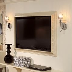 SO neat!! frame a flat-screen TV using crown molding... yes for the bedroom!