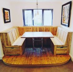 from @thesunnyshed - Just completed! Bespoke reclaimed wood banquette. Seating constructed entirely from pallet wood, with panelled detail, and storage drawers. Dining table from reclaimed scaffold boards, and entire structure raised on reclaimed pine floorboard platform. Immensely satisfying to see it complete, and one very happy customer!