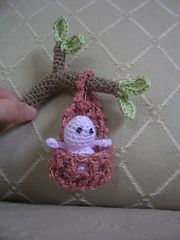 "Inspired by the work of many of my photo-prop crafting friends, here is my amigurumi version of a baby in a stork pouch or sling. Baby measures approx. 2"" seated. Pouch measures approx. 3.5"""