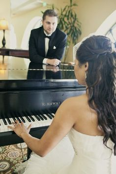 Love is Grand: A devoted groom admiring his beautiful bride while playing our grand piano in our Grand Ballroom Foyer