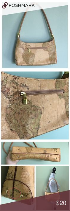 Vintage World Map Purse Beautiful purse, perfect for a traveler! I believe it is faux leather, as the material is unlabeled. There is also no brand label. Few minor marks. One little mark on one strap. One mark on lower corner. Marks shown in photos. The bottom has feet so it can stand. The bottom is in excellent condition. The inside is also in excellent condition. But, to be honest, is a little cheap feeling. The material inside is very thin. Bags Shoulder Bags