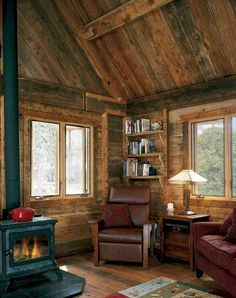 small wood-burning stove acts as the main heat source in Kathy and Leonard Winograd's home. With the help of the insulation between the interior planking and stone facade, the stove makes for a warmer home at feet than many houses at half that elevation. Timber Cabin, Timber House, Log Cabin Living, Home And Living, Living Room, Small Living, Cozy Living, Small Log Cabin, Small Cabins