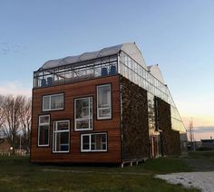 This Eco-Friendly Family Moved Inside a Giant Greenhouse: Take a Look Inside