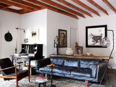 ellen degeneres and portia de rossi have a lovely old black leather sofa
