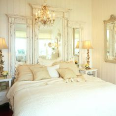 chandelier and mirrored headboard