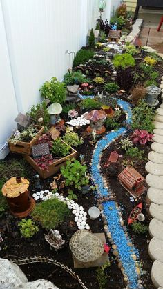 Fairy village. Fairy Garden. Miniature fairy garden Try in backyard against house? #miniaturegardens