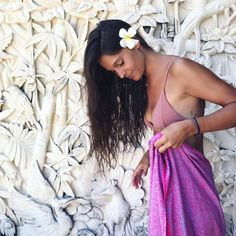 is wearing a and as a single in her lush brown hair. Locally known as the frangipani is signature flower. It is often used in religious or 📷 by musthaves Adele, Batik, S Signature, Surfs, Hippie Chic, Resort Wear, Flowers In Hair, Free Spirit, Brown Hair