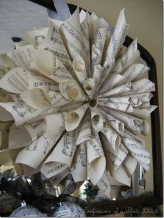 Sheet music wreath.... make this for above the piano?!