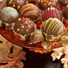 Cake balls are the perfect dessert for every holiday or event. Decorate them with fall colors and sprinkles for a sweet treat this autumn.