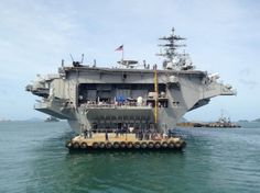 Here we go . . . moving close to the USS Nimitz off Phuket today.  Live coverage photos from Phuket Wan Tourism News