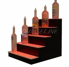 "Led 5 Step Bar & Home bottle Shelf 28 by Led Baseline Inc. $571.00. These lighted bottle shelves feature a thin first level shelf and a taller second shelf that gives great bottle label exposure and allows for easy placement and removal. Construction These units are built to suit your needs, simply select the width option that fits your bar Dimensions: 21"" tall x 21.75"" deep x 28"" Semi-gloss black finish and impact, scratch resistant acrylic top LED specs Re..."