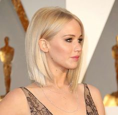 Straight-haired ladies: Snip those frayed ends into a clean, asymmetrical line like J.Law here. - Getty Images