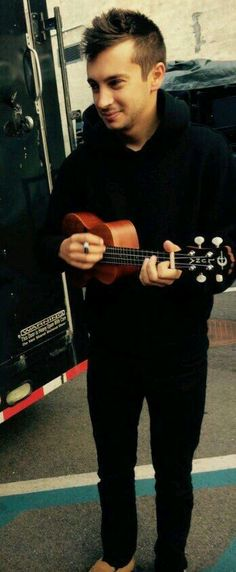 Him and his lil ukulele! Look at that! Look at that adorable lil smol bean