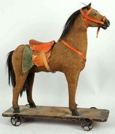 Horse Pull Toy Deze gelijkt erg veel op dat paardje welke ik heb gehad Ik noemde hem Ponnek,