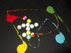 golf balls, paint, colour mixing activity. Roll the balls around tuff tray and make prints from the marks they make.