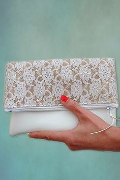 This would be a cute bridesmaid gift. The handbag part of the clutch can match the wedding, comes in 50 different colors. (scroll down to #8 on the page). #MyOnlineWeddingHelp