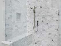 Step 4 in swapping your tub for a sleek new shower: Pick your waterproofing materials and drain, and don't forget to test