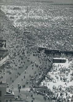 coney island.......way too many people!!  * It's wall to wall people*  I don't see how they can even find room to breath *pa