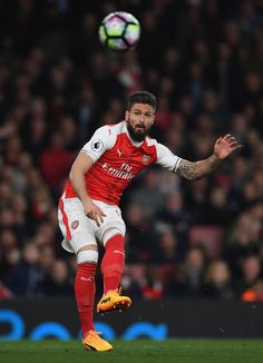 Olivier Giroud Photos Photos - Olivier Giroud of Arsenal scores during the Premier League match between Arsenal and West Ham United at Emirates Stadium on April 5, 2017 in London, England. - Arsenal v West Ham United - Premier League