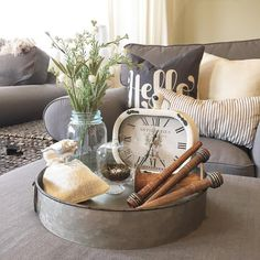 Galvanized container with vignette of clock and other vintage items