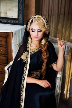 Algerian fashion: black bernoose