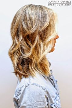 "This is one of the most requested colors cuts all year round! A natural looking beige blonde base with bright buttery blonde highlights and a piecey long bob with minimal long layers that help create that ""lived in"" look. We love it as a fresh summer look! Box No. 216"